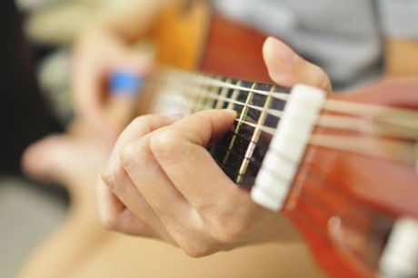 Two or Four 30-Minute Guitar Lessons at Guitar Cities