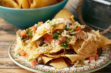 Nachos, Chicken Wings or Ribs with a Side for One, Two or Four at Mexican House Bar and Grill