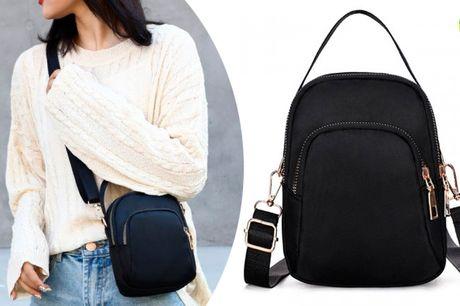 Vandtæt crossover taske i stilrent og praktisk design, med mange lommer.