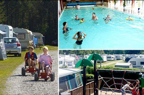 Dejlig 4½ stjernet ferie med familien  - 3 nætter eller en uge i egen campingvogn eller telt for 1 familie med hjemmeboende børn. Inkl. pladsgebyr, aktiviteter, internet mm. Værdi op til kr. 2940,-