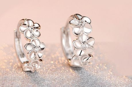£5.99 (from Styled By) for a pair of crystal flower mini hoop earrings!