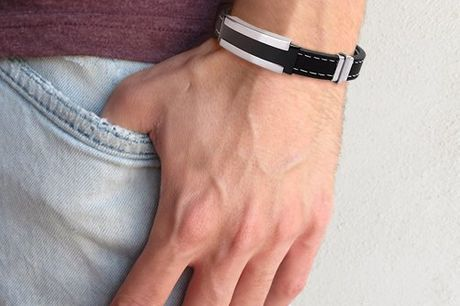 Stylish Bracelet for Men. Stylish accessory to help complete any outfit. This sturdy bracelet is made of rubber and has metal details. High quality, timeless design. Recommended for fashionable men