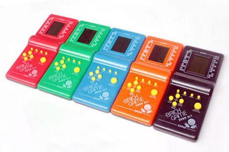 Tetris classique jeu à main. Console old-school pour les jeux classiques. A 9999 jeux dans 1 jouet Brick Game. Comprend des jeux comme le tétris, les serpents et bien d'autres. Léger et facile à transporter.