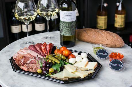 Tapas til 2 + en flaske vin. Hent mad og vin fra Tapas 2 Go på Frederiksberg