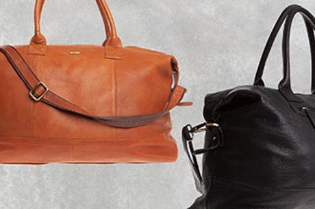 Flot og rummelig Bon Goût rejsetaske i blød skindkvalitet. Vælg mellem cognacfarve og sort.