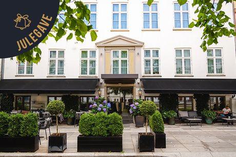 Bo på Hotel Skt. Annæ i hjertet af byen inkl. økologisk morgenmad. 1 dejlig overnatning i deluxe-værelse, økologisk morgenmad, cykel-leje, parkering og fitness