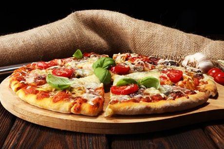 Slapen & dineren: kamer voor 2 pers. incl. ontbijt, naar keuze met pizzadiner in Holiday Inn Express Amsterdam City Hall