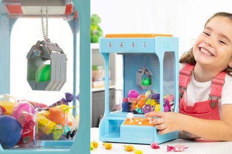 Grijpmachine met licht en geluid Voor snoepjes en speelgoed<br /> Afmeting 18 x 41 x 16 cm<br /> Haal de kermis in huis