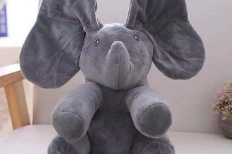 Peek-A-Boo Elefant. Peek-A-Boo elefant på hele 30 cm vil med sikkerhed fange dit barns opmærksomhed i flere timer! Den indeholder 2 sjove og lærerige funktioner for dit barn Den vil underholde dit barn i flere timer med sang og leg og udvikle dit barn's