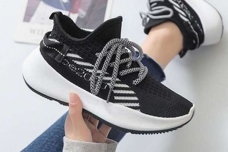 £9.99 for a pair of women's stripe detail mesh trainers in black, grey or pink and UK sizes 3-8 from Evaniy!