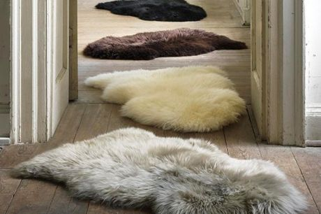 £11.99 instead of £29.99 for a super soft faux fur rug in Chocolate Brown, Grey, Cream, Dark Pink or Black from Direct Warehouse – save 60%