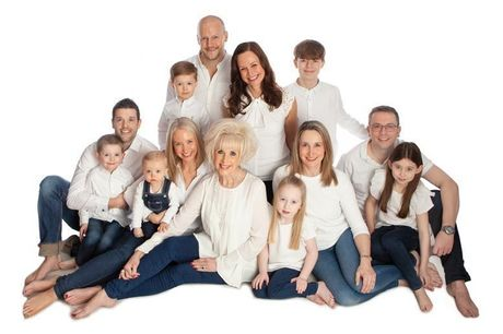 £12 for a one-hour family photoshoot for up to 12 people at Premier Photography, Hamilton with five mounted prints