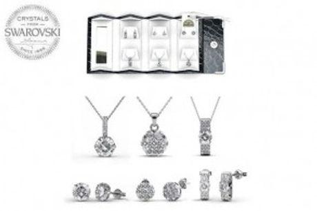 3 Smykkesæt i Rejseskrin.  Eksklusivt rejseskrinmed 3 smykkesæt, der er prydet med funklendeSwarovski krystaller.