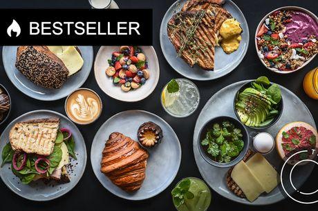 Frit valg hos THEOS på Østerbrogade. Smag på byens bedste bagværk, kaffe, sandwich, chokolade og...