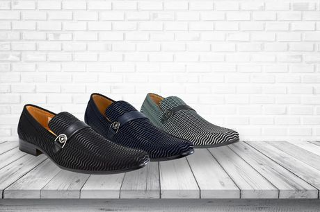 £14.99 instead of £19.99 for a pair of men's Italian-style loafers in black, blue and black or white and black and UK sizes 6-11 from Shoe Fest - save 25%